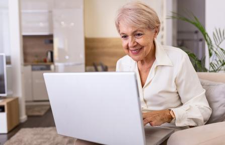 Older woman working on a computer.