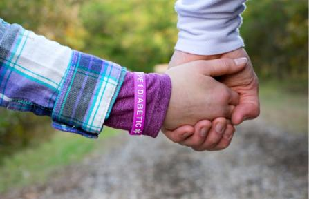 Child holding parent's hand.