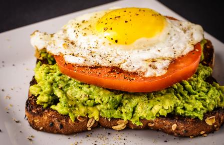wheat toast with mashed avocado and tomato