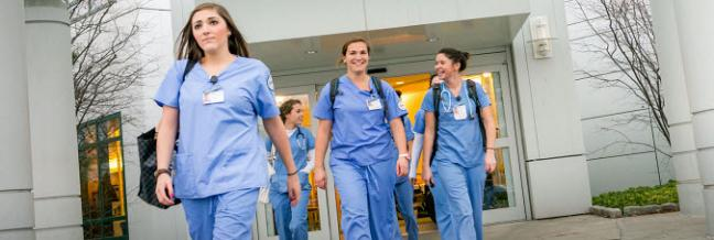 A group of young nurses walk together.